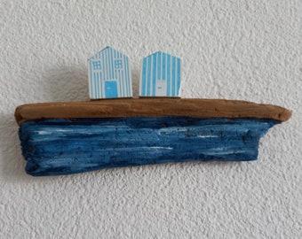 maritime beach houses with strips, driftwood as beach & sea