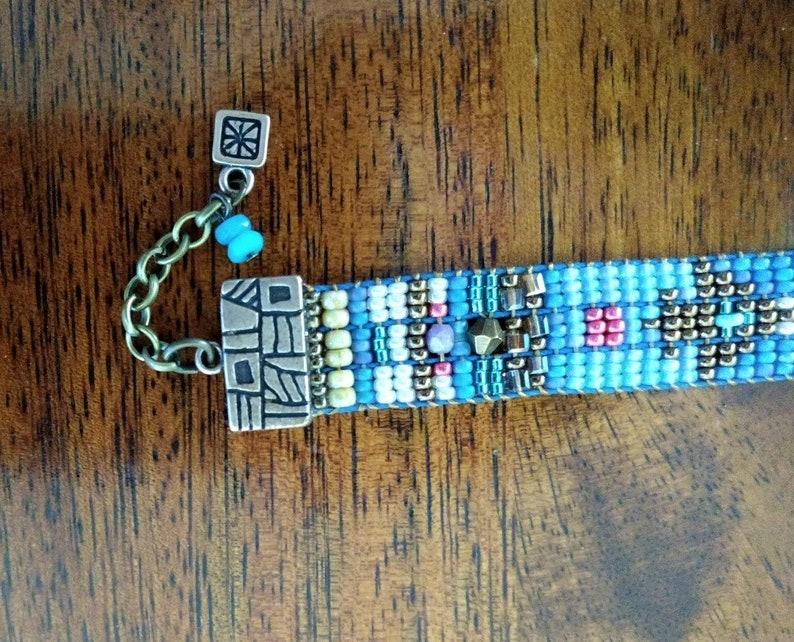 BLUE ARROWSHandmade One-of-a-Kind Crystal Glass and Bronze Loom-Woven Adjustable Bracelet