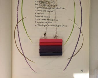 Long necklace with wooden monies of colored pencils in various shades of pink and violet
