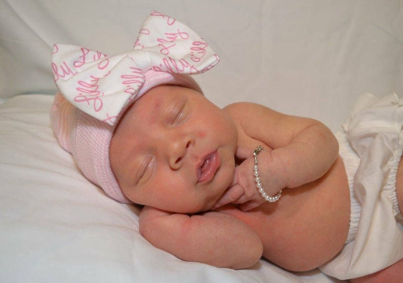 3f436ece465 Personalized newborn hat and or headband with baby name bow.