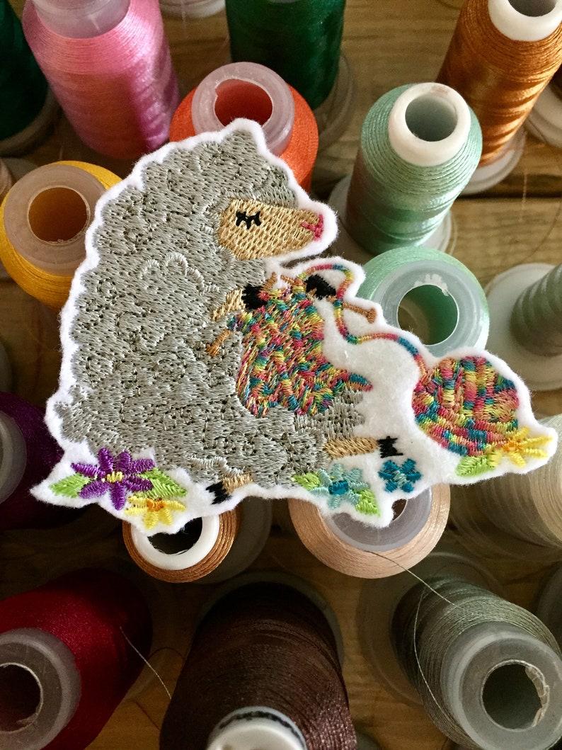 Patch Knitting Sheep on white felt