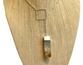 Raw Citrine square bar pendulum lariat necklace on sterling silver chain sterling silver octagon ring center piece.