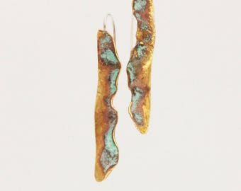 Unique, elegant earrings with patina