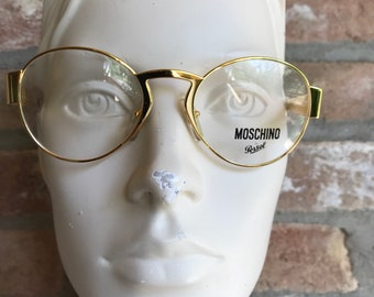 50375647c6d Moschino by Persol round gold sunglasses