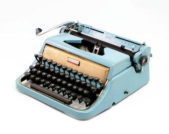 Restored vintage typewriter, Underwood Ace, blue