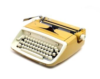 Restored vintage typewriter, Royal Safari, yellow