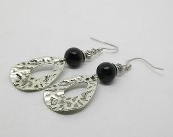 Hammered silver pendant, black glass bead earrings