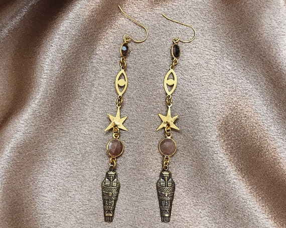 Neith Goddess Earrings with Egyptian Mummy Charms, Stars, Evil Eyes, Smokey Quartz, and Peach Moonstone