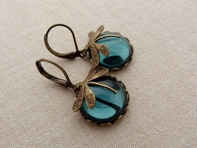 dragonfly earrings . Ink moons . ink blue montana sapphire image 0