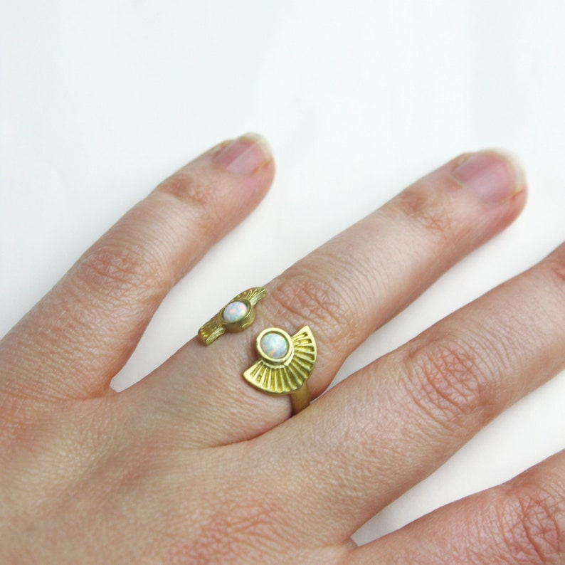 Ornament brass ring with small white opal stones