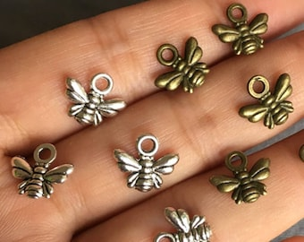 Pack of 50 Mini Bee Charms. Bronze & Silver Colour Available. 10mm x 11mm Pendants.