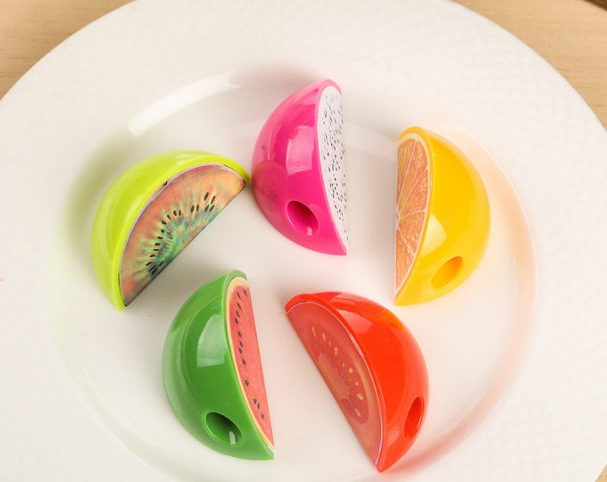 Fruit Slice Pencil Sharpener. Food Theme School and Office Stationery.