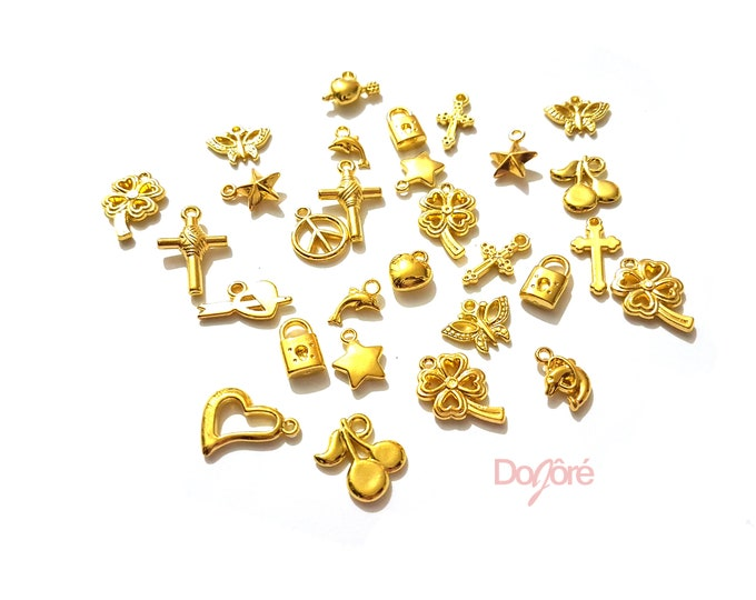 CLEARANCE Pack of 100 Assorted Gold Coloured Symbol Charms. Mix Bag Clover Cross Heart Peace Pendants