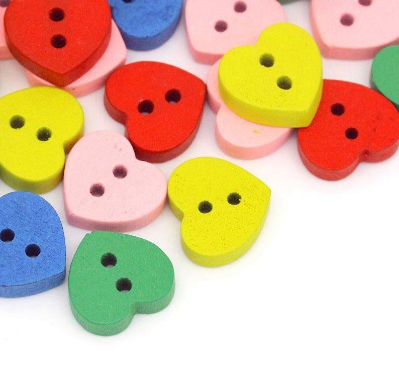 Pack of 100 Assorted Mix Wooden Heart Buttons. 11mm x 12mm image 0