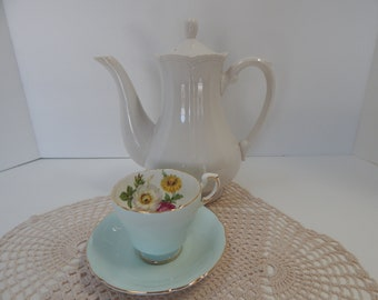 Paragon tea cup and saucer in pale aqua with mixed floral's