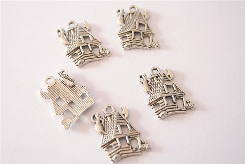 ref:2322 20 antique silver charms. .