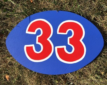 Football with number to be placed under large or medium football helmet.