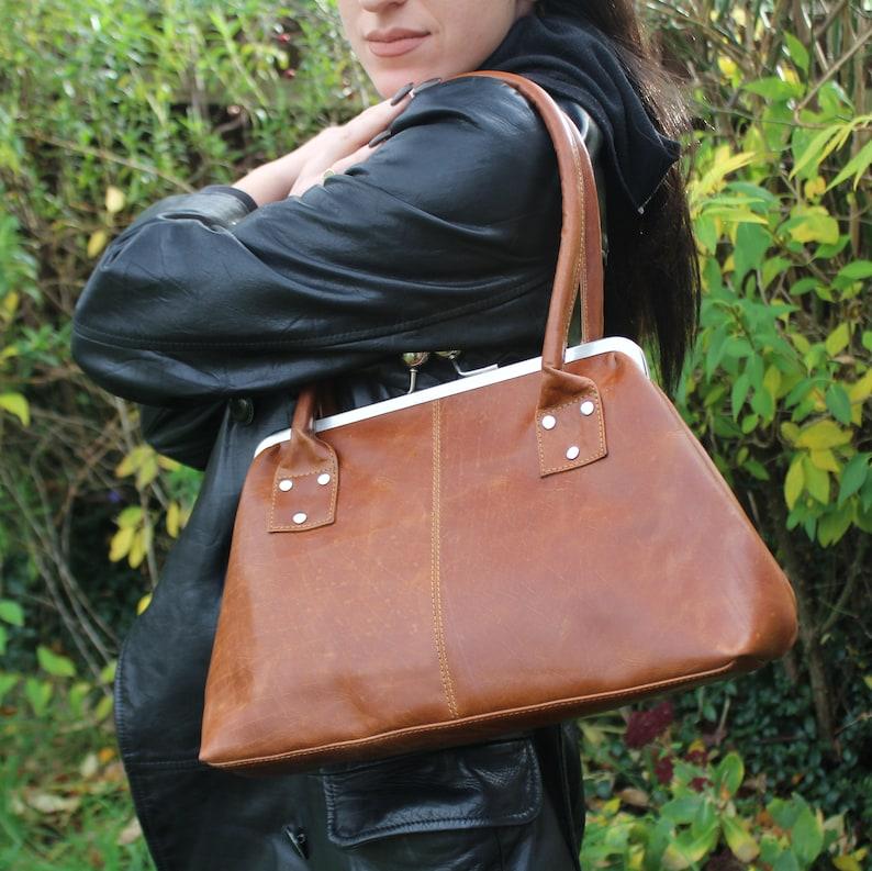 1940s Handbags and Purses History Doris Clipframe Shoulder Bag Variant Tan Leather Limited Edition $107.44 AT vintagedancer.com