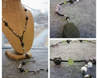 Lariat w/ green STARS, a RIVERSTONE drop, seed beads, cat's eye beads, hematite, sterling rounds
