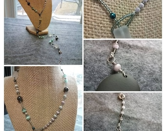 Lariat w/ a MOON face, riverstone drop, seed beads, cat's eye beads, hematite, sterling rounds, cultured freshwater pearls & Czech glass