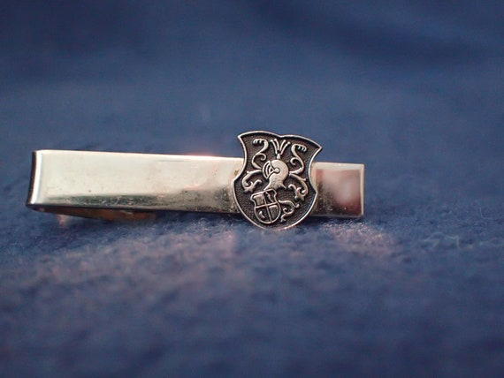 Tie Bar - Black Shield Featuring a Helmet and Shie