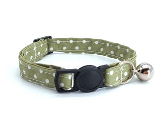 Dusky green spot fabric with breakaway safety collar