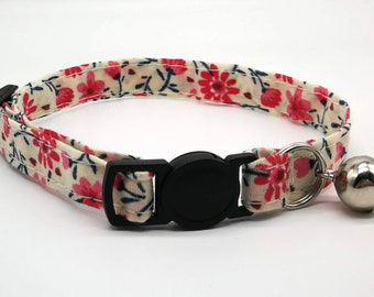 Pink spring daisy fabric design with breakaway clasp