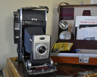 Polaroid Electric Eye land camera - 1960s with cowhide case, Model 900.