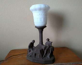 Vintage table lamp - ladies playing music. Beautiful design but Needs new wiring. Working.