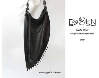 Ombra with spikes is an extravagant and bizarre design bag. Soft genuine leather, handmade in Italy