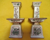REDUCED PRICE Pair of Oriental vintage 8 inch tall antiqued white and gold candleholders with 4 different panels of flowers from Macau