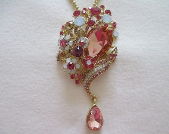 Large pink pear shape rhinestone, opal look gems brooch / necklace from the 80s   PRICE REDUCED