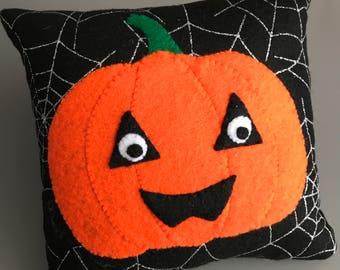 A Halloween Pumpkin Felt Cushion