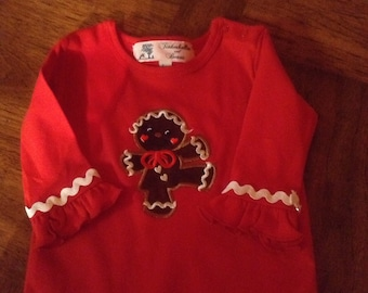 03c0615f3fc4 Baby girl or toddlers one piece knit romper appliqued with a dancing  gingerbread girl.