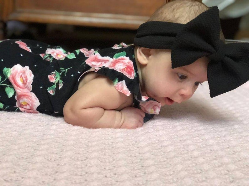Black and pink floral romper with snaps