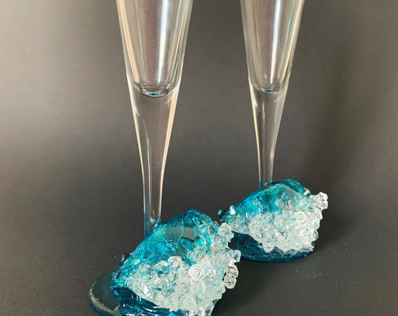 Ocean waves wedding toasting glasses