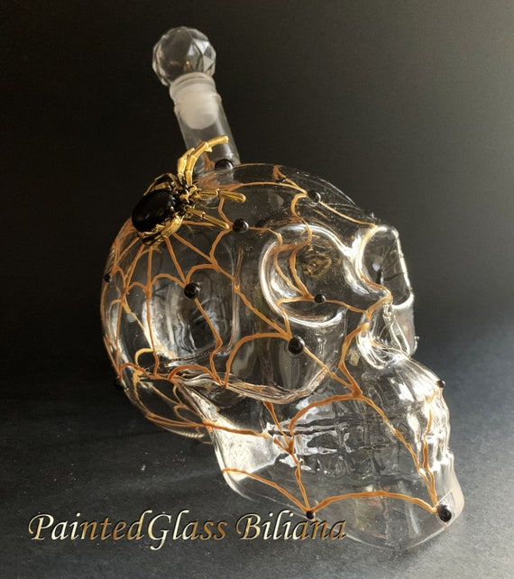 Gold black spider web skull bottle