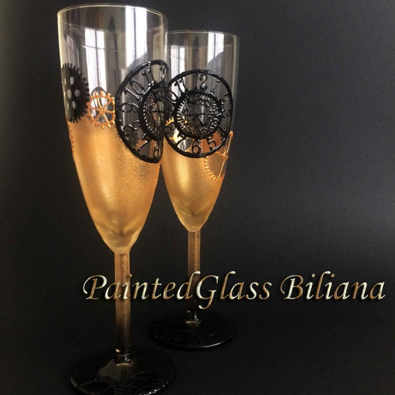 Steampunk gears toasting glasses in gold and black, set of 2