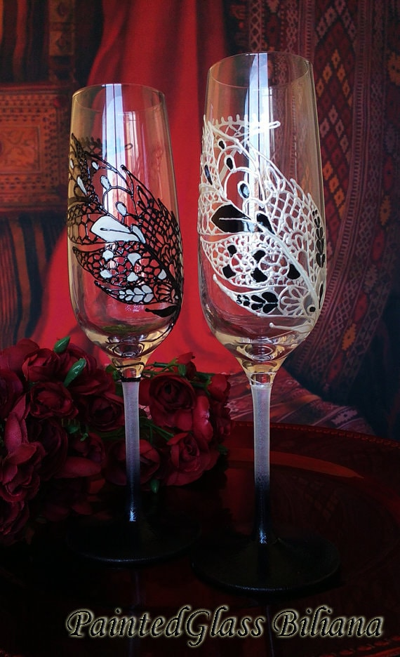 CRYSTAL SET of 2 hand painted Wedding Glasses champagne flutes feather theme in white and black color