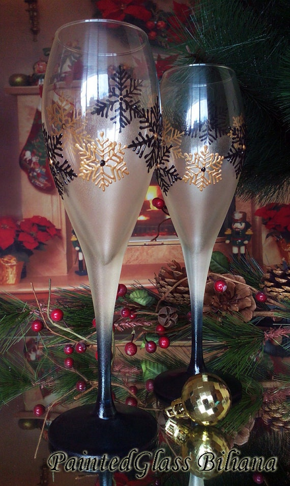 Set of 2 Winter Wedding toasting hand painted champagne flutes Snowflakes in gold and black color