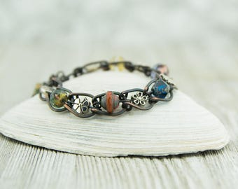 Copper horseshoe bracelet with Czech glass beads, multiple colors and shapes, plated silver floral accents, handcrafted, nickel free