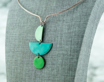 Geometric enamel pendant necklace, shades of green, half circle, copper neck wire, hand crafted, nickel free jewelry