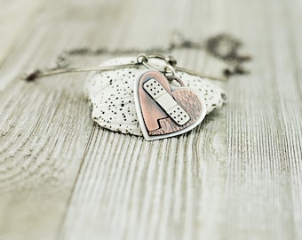 Mixed metal broken heart necklace, mended heart, bandaid heart, copper and silver, handcrafted, nickel free