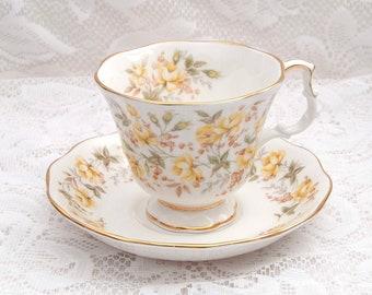 Royal Albert Yellow Ribbon Teacup / Saucer, Yellow Flowers, Green Leaves, Gold Trim, Rose Chintz Series, Vintage, 1982, Bone China, England