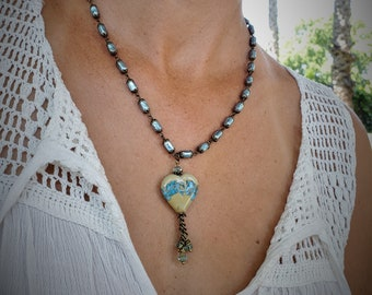 Blue Ocean Heart Necklace, An Ocean Wave  ampwork Heart Beautifully Set On An Aqua blue Czech Bead Glass Pearl Chain
