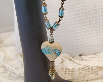 Blue Ocean Heart Necklace, An Ocean Wave  ampwork Heart Beautifully Set On An Aqua blue Czech Bead Glass Pearl Chain