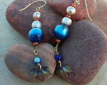 Blue earrings, Leaf earrings, iridized metal, sapphire colored beads, gold plated ear wires