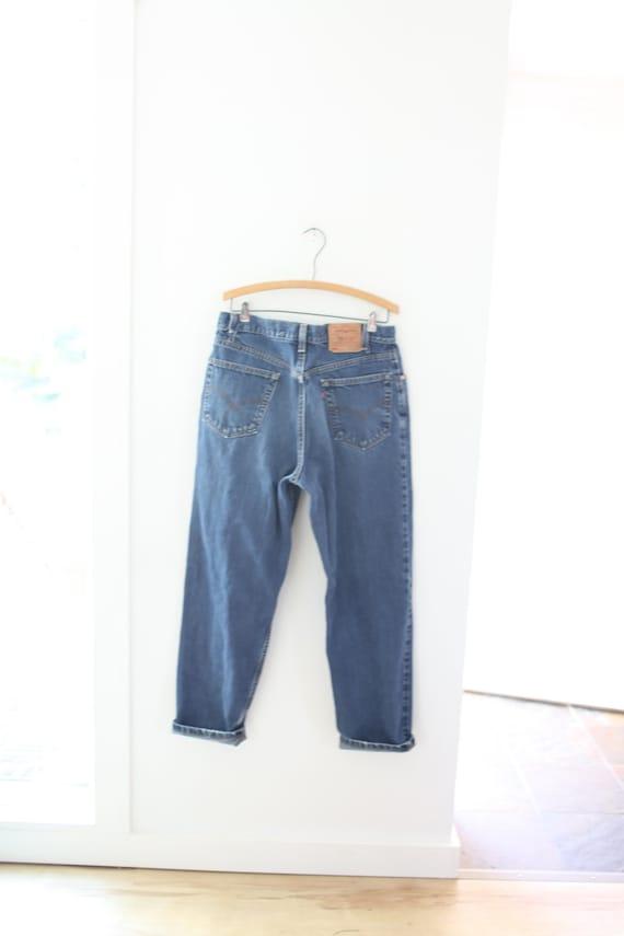 vintage 1990's  distressed levis 550  jeans denim… - image 1