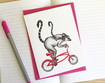 Cycling lemurs card, mommy and baby lemur on bicycle