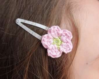 White hair clip with pink crocheted flower.